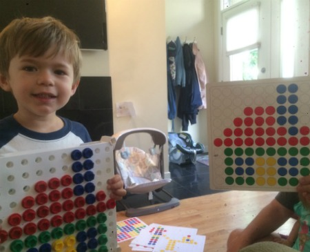 Busy Box for Toddlers - Boy Holding Design and Drill completed project